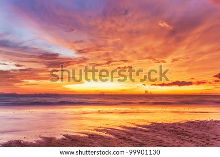 Tropical beach at beautiful sunset. Nature background - stock photo