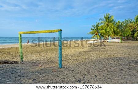 Tropical beach at dusk with football goal on the sand, Caribbean, Manzanillo, Costa Rica - stock photo