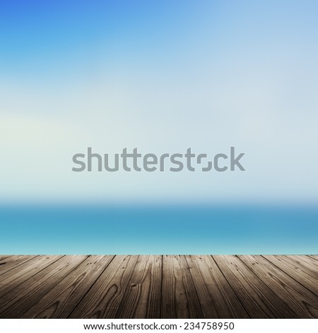 Tropical beach background with blurred sea and wooden table - stock photo