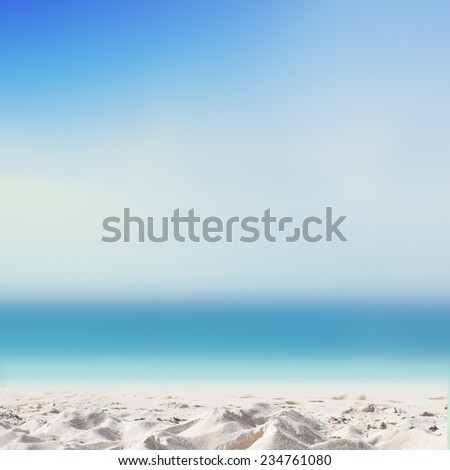 Tropical beach background with white sand beach and soft blur sea - stock photo
