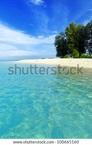 Tropical beach. Blue sky and clear water. - stock photo