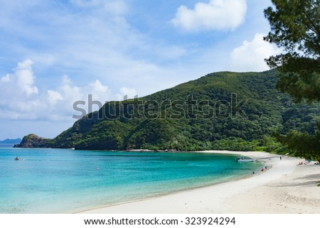Tropical beach cove with clear turquoise water, Tokashiki Island of Kerama Islands National Park, Okinawa, Japan - stock photo