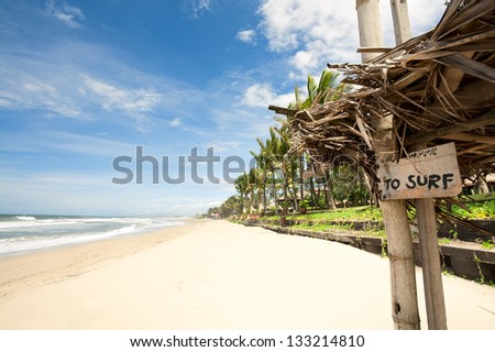 "Tropical beach in Bali Bali, Indonesia. nameplate ""to surf"" - stock photo"