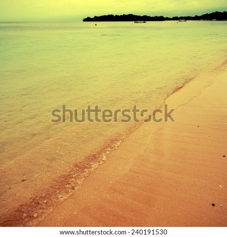 Tropical beach in Bali, Indonesia, instagram effect, square toned image - stock photo