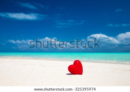 tropical beach in Maldives with few palm trees and blue lagoon - stock photo