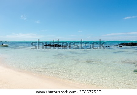 Tropical beach in Mauritius Island. Blue sky, blue lagoon, white sand