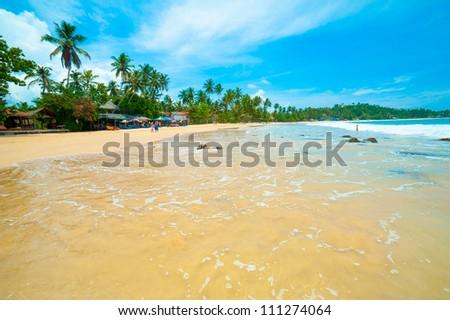 Tropical beach in Mirissa bay, Sri Lanka - stock photo