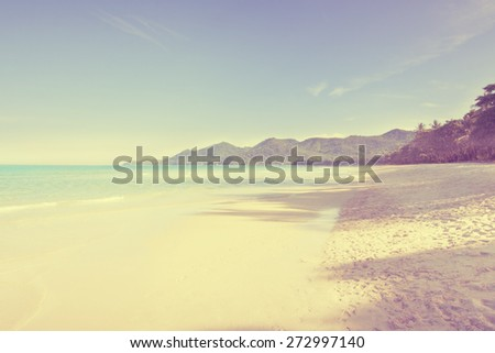 Tropical beach in sunny day - vintage effect. - stock photo