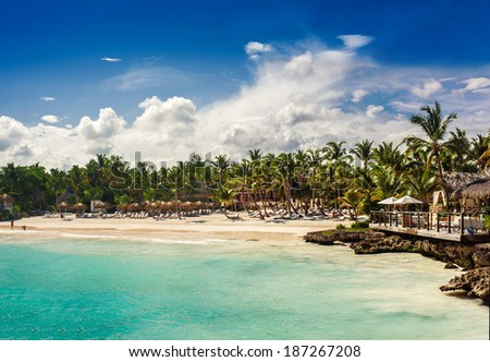 Tropical beach in sunset time. Sand, Palm trees, ocean and sky. beautiful beach and tropical sea. Dominican Republic, Seychelles, Caribbean, Bahamas. Relaxing on remote Paradise beach. - stock photo