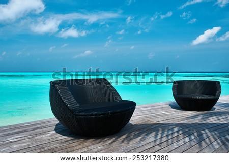 Tropical beach jetty at Maldives - stock photo