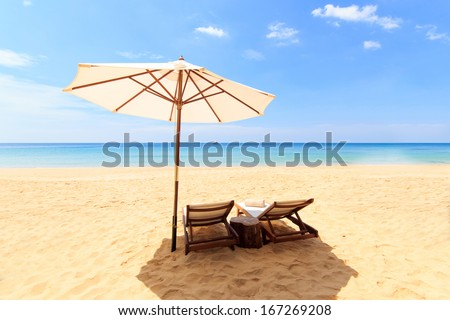 Tropical beach landscape with sunbeds and umbrella on Phuket island Thailand