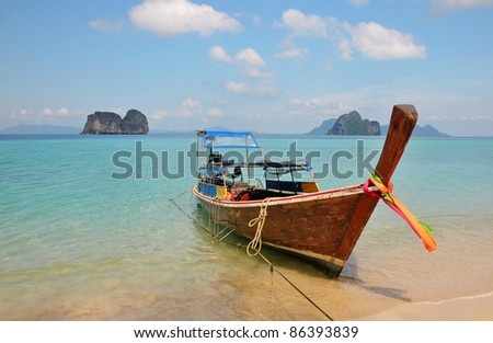Tropical beach, long tail boat, Thailand
