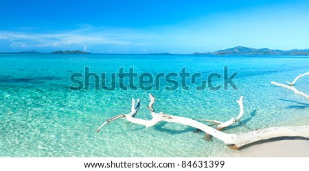 Tropical beach Malcapuya at summer sunny day. Panorama - stock photo