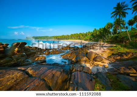 Tropical beach near Tangalle, Sri Lanka. Stones at foreground - stock photo