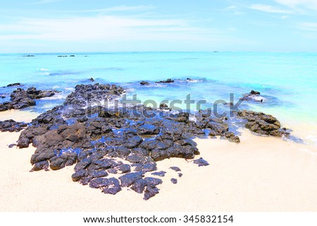 Tropical beach on Ile Aux Cerfs Island ( Mauritius Island), blue sea and sunny sky on a background. Greeting from paradise. - stock photo