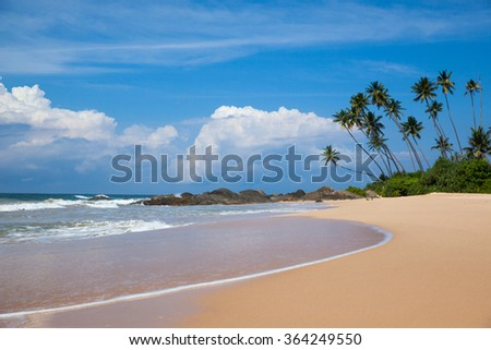 Tropical beach on indian ocean in Sri Lanka - stock photo