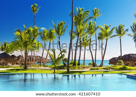 Tropical beach resort with umbrellas and lounge chairs in Punta Cana, Dominican Republic - stock photo