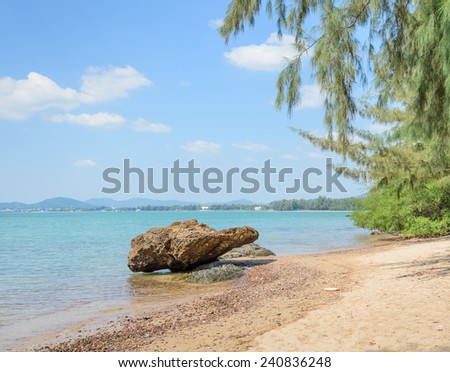Tropical beach shore with rock in Thailand