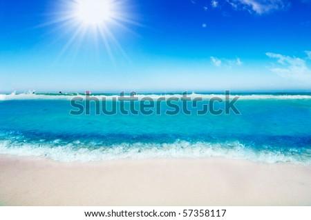 Tropical beach, sunny blue sky - stock photo