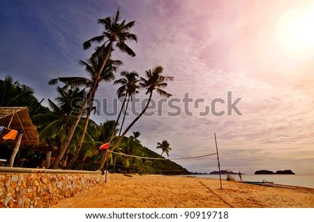 Tropical Beach Sunset With Volleyball net - stock photo