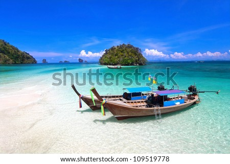 Tropical beach, traditional long tail boats, Andaman Sea, Thailand. - stock photo