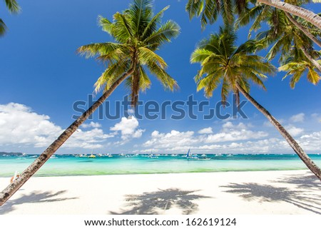 Tropical beach with beautiful palms and white sand, Philippines, Boracay Island - stock photo