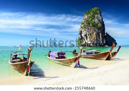 Tropical beach with boats.  Krabi, Thailand - stock photo