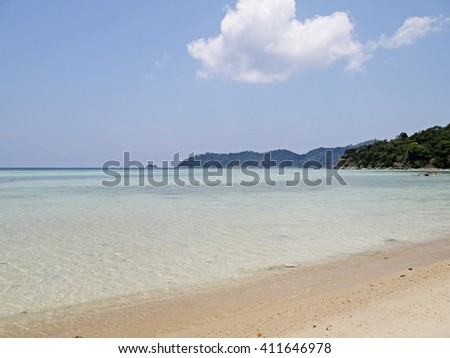 Tropical beach with clear blue water and white sand on a deserted coral island, Koh Adang south of Thailand. - stock photo
