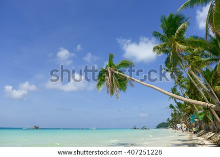 Tropical beach with coconut palm tree, white sand and turquoise sea water, Philippines, Boracay - stock photo