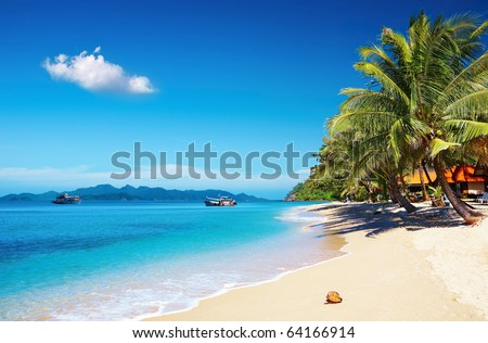 Tropical beach with coconut palms and bungalow, Thailand