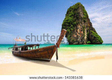 Tropical beach with limestone rock, Krabi, Thailand - stock photo