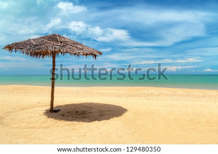 Tropical beach with parasol in Thailand - stock photo