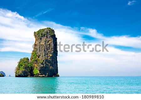 tropical beach with sea and limestone rock, Krabi, Thailand - stock photo