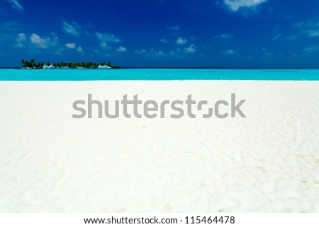 Tropical Beach with small palm tree Island and Sailboats - stock photo
