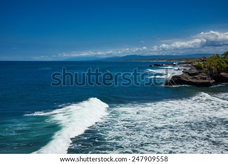 Tropical beach with volcanic rocks, Bali, Indonesia - stock photo