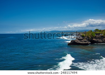 Tropical beach with volcanic rocks, Bali, Indonesia