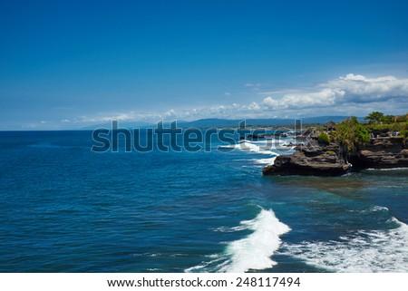 Tropical beach with volcanic rocks, Bali, Indonesia - stock photo