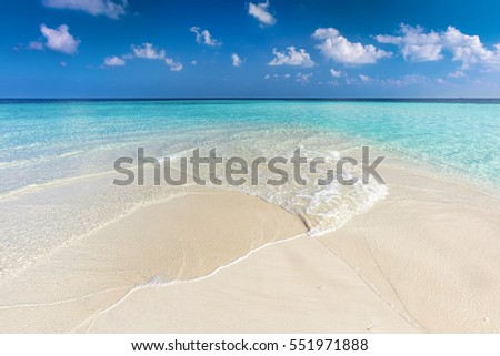 Tropical beach with white sand and clear turquoise ocean. Maldives islands.