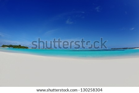 tropical beach with white sand at summer - stock photo