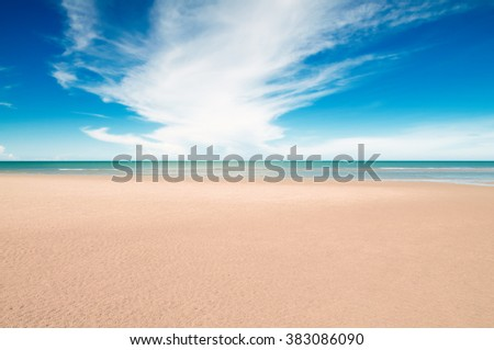 Tropical beach with white sand, fresh turquoise sea, deep blue sky and white clouds in Pranburi, Thailand.