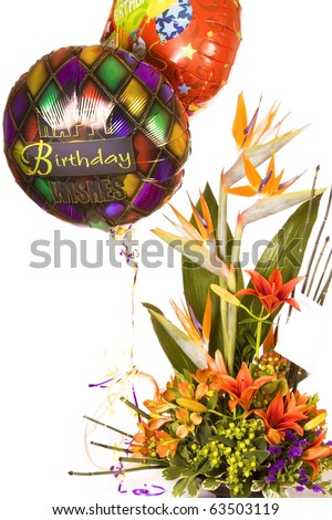 Tropical birthday bouquet from florist with balloons - stock photo
