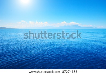 Tropical blue sea and blue sky with sun.