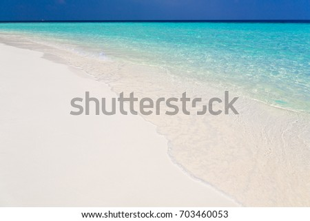 Tropical blue sea in island country Maldives. Amazing nature landscape. Wonderful luxury paradise. Beautiful exotic atoll. Travel background. Inspiration resort and white sand.