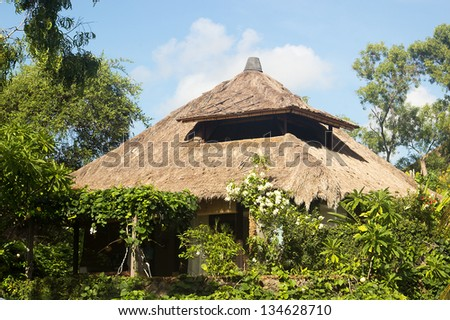 Tropical bungalow for a rest and relaxation. Beach house amongst trees and flowers