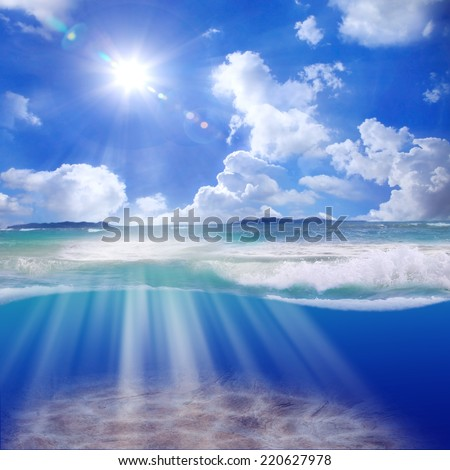 Tropical Caribbean sunlight with beautiful lenses flare and cloudy on blue sky design template. Beam shines through the seafloor ocean. - stock photo