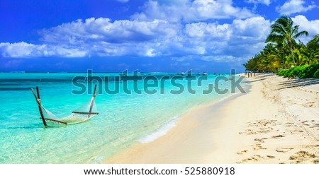 Tropical chilling out - hammock in turquoise water. Mauritius island
