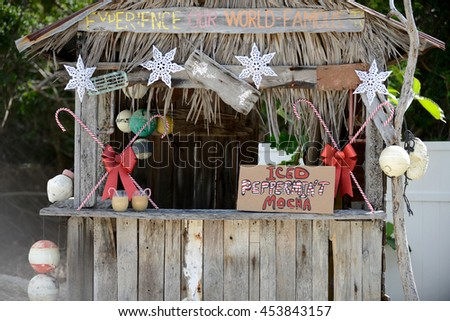 Tropical christmas concept with iced peppermint mocha stand