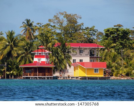 Tropical coast with colorful resort over the sea, Caribbean, Bocas del toro, Panama - stock photo