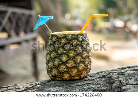 Tropical cocktail in pineapple - stock photo