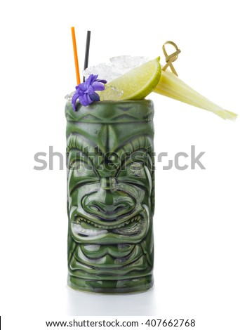 Tropical cocktail served in a tiki style glass and garnished with fruits - stock photo